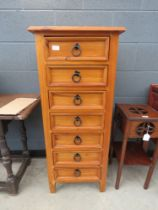 Narrow pine chest of 7 drawers