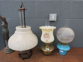 3 ceramic and brass oil lamps with shades