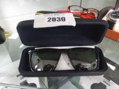 Pair of Nautica sunglasses with hard case