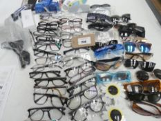 Bag containing assorted sunglasses and reading glasses