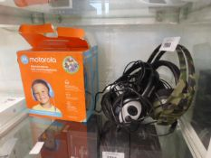 2 Motorola kids stereo wired headsets together with a gaming Plantronics headset and a Microsoft