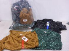 Bag containing ladies tops in black poker dot brown polka dots and green polka dots
