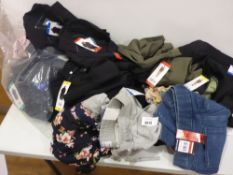 Bag containing ladies clothing, lounge wear and shorts by DKNY, ladies floral tops etc