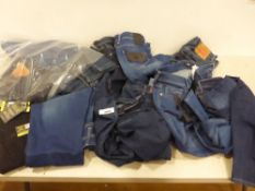 Bag containing various makes of ladies and men's jeans