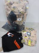 Bag containing ladies tops in pink floral and black various sizes by Jackson New York