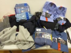 Bag containing men's shirts, fleece tops, hot weather tops etc