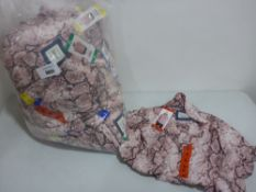 Bag containing ladies tops by Jackson New York in pink snakeskin