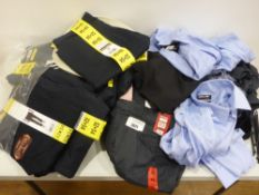 Bag containing men's clothing to include trousers, shorts, shirts etc in various sizes