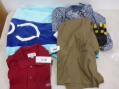 Small bag containing a pair of shorts working gloves polo shirts and a Calvin Klein large beach