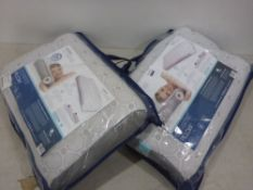 Two bagged Dormeo octasense pillow