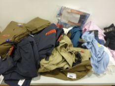 Bag containing men's clothing, including trousers, shorts, shirts etc