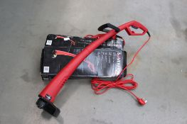 1 boxed and 1 unboxed Sovereign electric strimmers