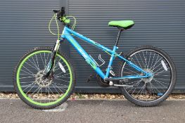 Blue and green childs mountain bike