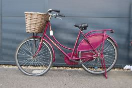 Cerise ladies bike with front basket and stand