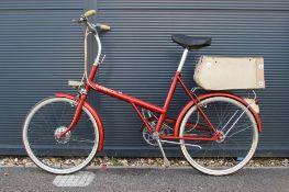 Twenty orange vintage ladies shopper style bike