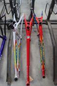 2 red Sigma carbon fibre bike frames and a white Sigma carbon fibre white bike frame (one owned by
