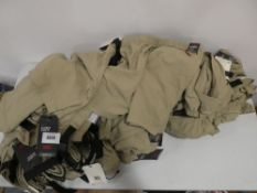 Bag containing khaki Levi's premium climber shorts, all tagged