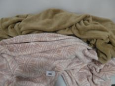 Pair of throws in brown and patterned pink
