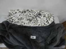 Pair of throws in dark grey and white with leaf motif