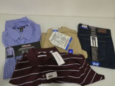 Bag containing Calvin Klein polo shirts, Kirkland sports shirts, WearFirst stretch shorts and