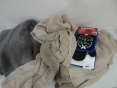 Bag containing towels and a Cuisinart 4-piece BBQ set