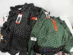 Bag containing Jachs girlfriend blouses in green with black polka dots as well as gold with black