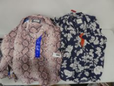 Bag containing Jachs girlfriend blouses in blue with floral pattern and pink with snakeskin pattern,