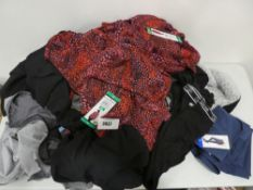 Bag containing a selection of ladies tagged clothing including Mondetta leggings, Calvin Klein