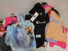 Bag containing children's clothing including Disney Frozen hooded top, Champion hooded top, Puma top