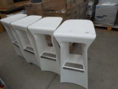 4 white plastic bar stools