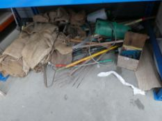 Large underbay of hessian sacks and garden tools
