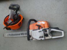 Orange and white petrol powered chainsaw with Husqvarna helmet