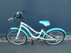 White and turquoise child's cycle