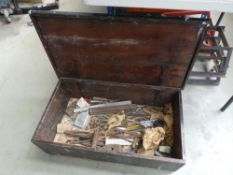 Wooden toolbox with an assortment of tools