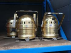 4 gold coloured stage lights