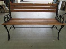 Slatted wood garden bench with cast metal legs