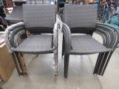 2 grey rattan stacking garden chairs on grey support
