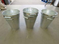 7 galvanized bucket style planters
