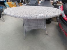 Circular rattan table in grey with 4 chairs