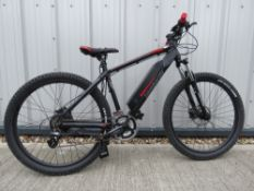 CST Rock Hawk electric mountain bike in black and red with charger