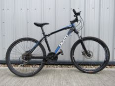 Giant mountain bike in black with front suspension