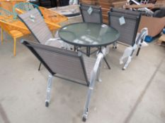 Circular glass top garden table with 6 matching chairs