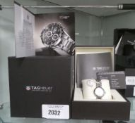 Tag Heuer ladies watch with diamond face dial, precious stones certificate, instruction manual and