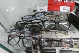 10 various reading glasses and sunglasses frames by Rayban, Guess, Versace, etc.