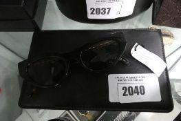 Pair of Stella McCartney sunglasses with case, SC0193S
