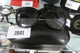 Pair of ladies black framed Coach sunglasses with hard case, 5002T3