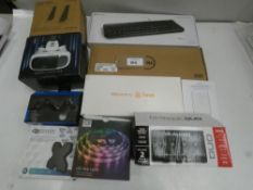Bag containing M-Audio M-Track Duo, 2x wired keyboards, VR goggles, PC speakers, Gioteck wireless