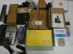 Bag containing digital alarm clock, blood pressure monitor, Sky accessories, home phones, etc