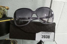 Pair of ladies Gucci sunglasses in purple frames with case, GG0506S