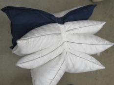 3 unbagged Hotel Grand pillows plus bagged Optisense pillow